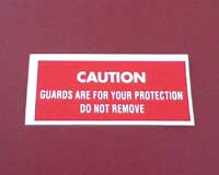 Mower deck decal - Guard removal caution